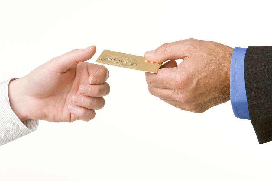 credit-card-passing-hand-to-hand